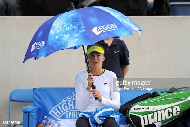 Slovakia's Daniele Hantuchova shelters under a umbrella during her semi final against USA's Alison Riscke during the AEGON Classic at Edgbaston...
