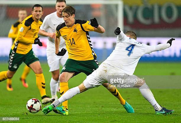 Slovakia's defender Jan Durica and Lithuania's Vykintas Slivka vie for the ball during the World Cup 2018 qualification football match between...