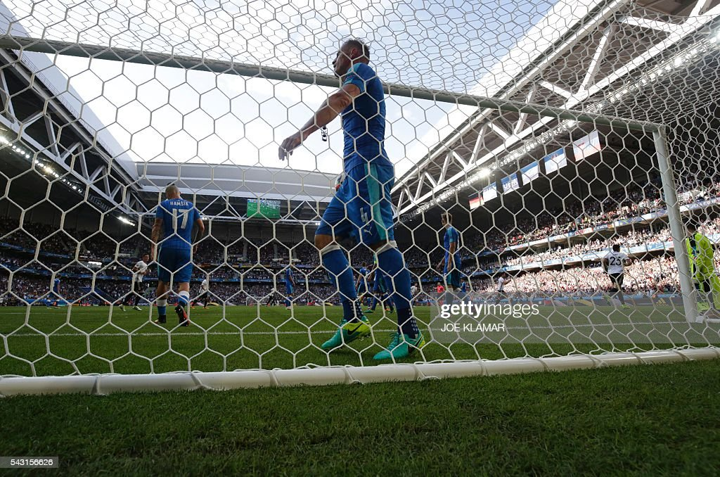 Slovakia's defender Jan Durica recats after Germany's midfielder Julian Draxler scored during the Euro 2016 round of 16 football match between Germany and Slovakia at the Pierre-Mauroy stadium in Villeneuve-d'Ascq, near Lille, on June 26, 2016. / AFP / JOE