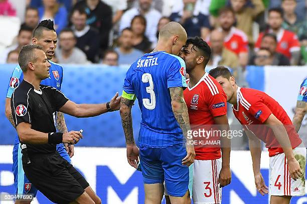 TOPSHOT Slovakia's defender Martin Skrtel challenges Wales' defender Neil Taylor during the Euro 2016 group B football match between Wales and...