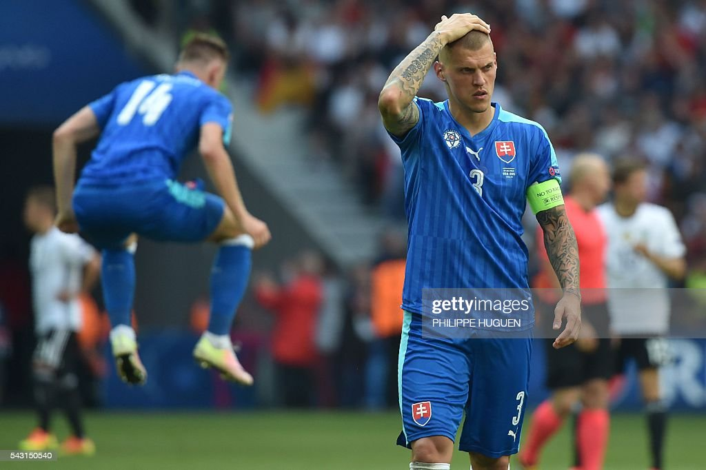 Slovakia's defender Martin Skrtel reacts during the Euro 2016 round of 16 football match between Germany and Slovakia at the Pierre-Mauroy stadium in Villeneuve-d'Ascq, near Lille, on June 26, 2016. / AFP / PHILIPPE
