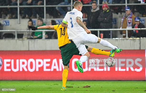 Slovakia's defender Martin Skrtel vies with Lithuania's Vykintas Slivka during the World Cup 2018 qualification football match between Slovakia and...