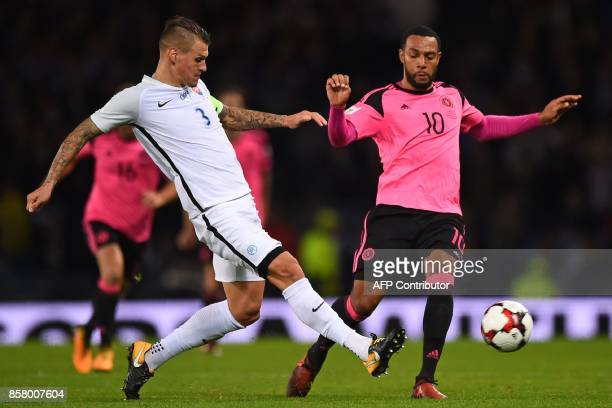 Slovakia's defender Martin Skrtel vies with Scotland's midfielder Matthew Phillips during the FIFA World Cup 2018 qualifying football match between...