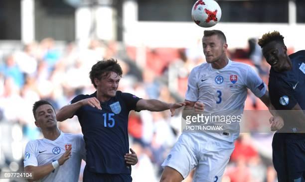 Slovakia's defender Milan Skriniar and England's midfielder John Swift vie for the ball during the UEFA U21 European Championship Group A football...