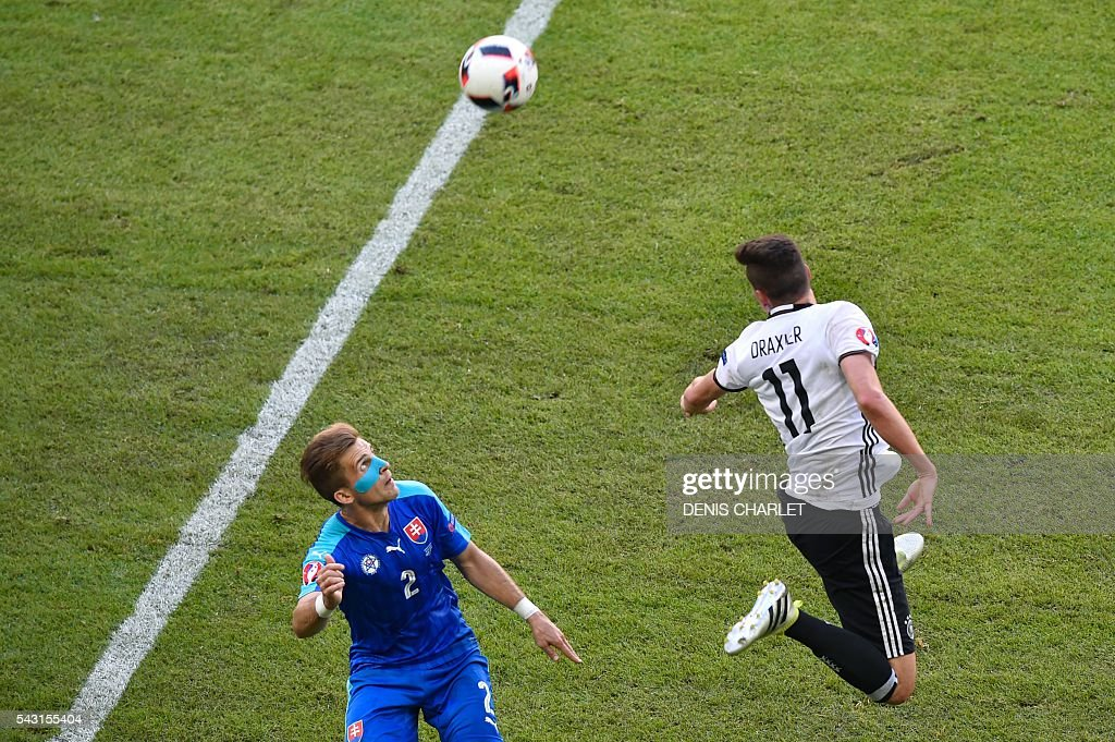 Slovakia's defender Peter Pekarik (L) vies with Germany's midfielder Julian Draxler during the Euro 2016 round of 16 football match between Germany and Slovakia at the Pierre-Mauroy stadium in Villeneuve-d'Ascq, near Lille, on June 26, 2016. / AFP / DENIS