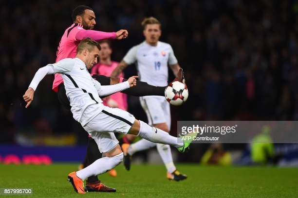 Slovakia's defender Peter Pekarik vies with Scotland's midfielder Matthew Phillips during the FIFA World Cup 2018 qualifying football match between...
