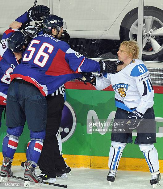 Slovakia's defender Vladimir Mihalik fights with Finland's forward Antii Pihlstrom during the preliminary round match Finland vs Slovakia of the IIHF...
