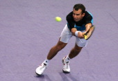 Slovakia's Dominik Hrbaty returns to Russia's Nikolay Davydenko during their Paris Tennis Masters Series final match at Bercy indoor tournament 05...