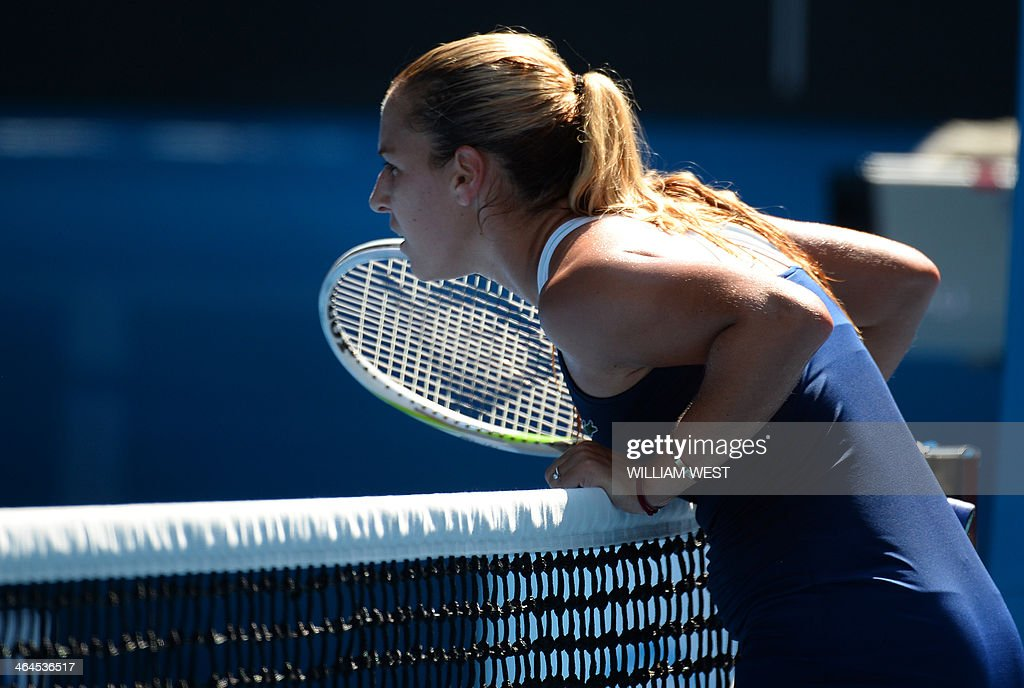Slovakia's Dominika Cibulkova leans on the net during her women's singles semi-final match against Poland's Agnieszka Radwanska on day eleven of the 2014 Australian Open tennis tournament in Melbourne on January 23, 2014. IMAGE