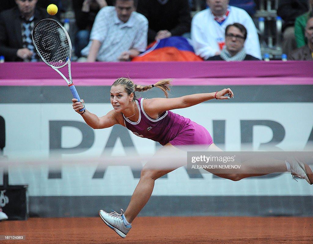 Slovakia's Dominika Cibulkova returns a ball to Russia's Maria Kirilenko during their Federation Cup tennis semi-final match in Moscow on April 21, 2013.