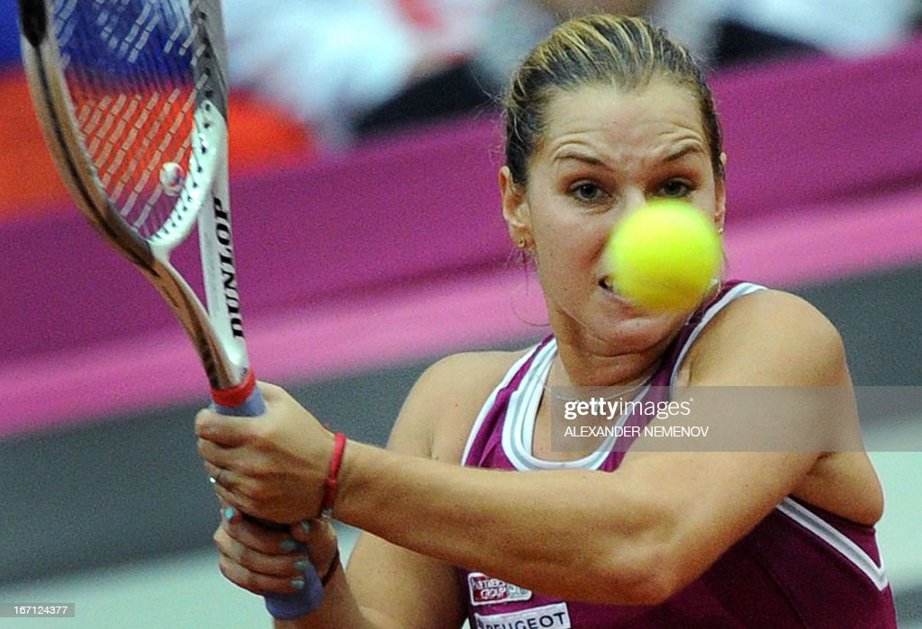 Slovakia's Dominika Cibulkova returns a ball to Russia's Maria Kirilenko during their Federation Cup tennis semi-final match in Moscow on April 21, 2013.