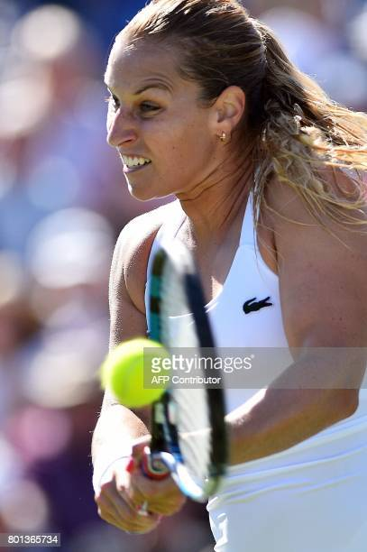 Slovakia's Dominika Cibulkova returns against Britain's Heather Watson during their women's singles second round tennis match at the ATP Aegon...