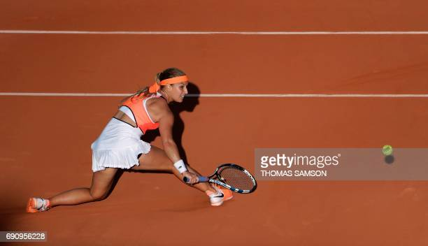 TOPSHOT Slovakia's Dominika Cibulkova returns the ball to Tunisia's Ons Jabeur during their tennis match at the Roland Garros 2017 French Open on May...