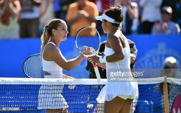 Slovakia's Dominika Cibulkova shakes hands after losing to Britain's Heather Watson during their women's singles second round tennis match at the ATP...