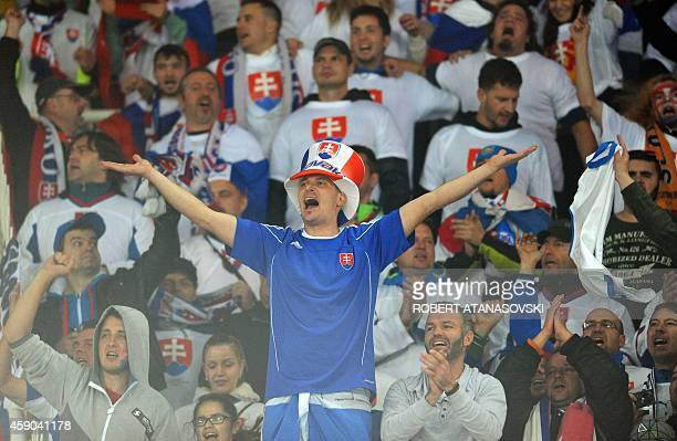 Slovakia's fans celebrate during the UEFA Euro 2016 qualifying football match between Macedonia and Slovakia at the Filip II stadium in Skopje on...