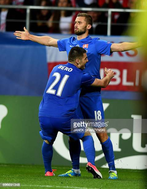 Slovakia's forward Pavol Safranko celebrate scoring with his teammate midfielder Matus Bero during the UEFA U21 European Championship Group A...