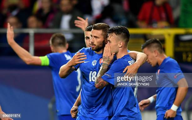 Slovakia's forward Pavol Safranko celebrate scoring with his teammate Albert Rusnak during the UEFA U21 European Championship Group A football match...