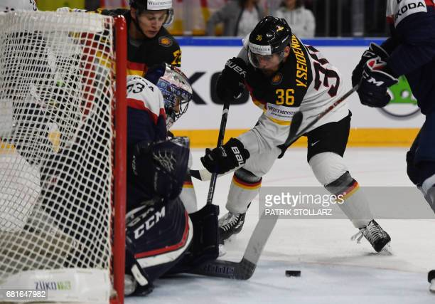 Slovakia´s goalkeeper Julius Hudacek and Germany´s Yannik Seidenberg vie during the IIHF Ice Hockey World Championships first round match between...