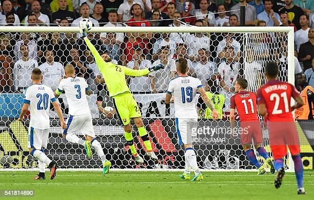 TOPSHOT Slovakia's goalkeeper Matus Kozacik clears a cross during the Euro 2016 group B football match between Slovakia and England at the...