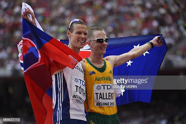 Slovakia's gold medallist Matej Toth and Australia's silver medallist Jared Tallent pose with their national flags at the end of the final of the...