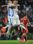 Slovakia's Jan Durica and Martin Skrtel celebrate their victory 21 during Euro 2016 qualifing football match between Slovakia and Spain in northern...
