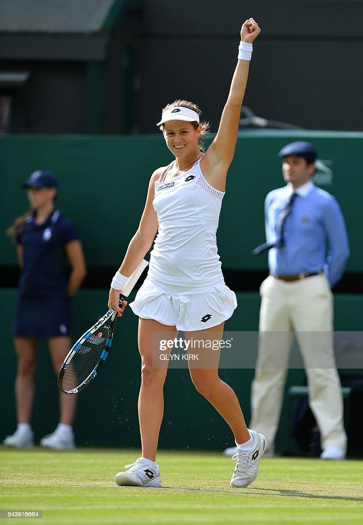 Slovakia's Jana Cepelova celebrates beating Spain's Garbine Muguruza during their women's singles second round match on the fourth day of the 2016 Wimbledon Championships at The All England Lawn Tennis Club in Wimbledon, southwest London, on June 30, 2016. / AFP / GLYN