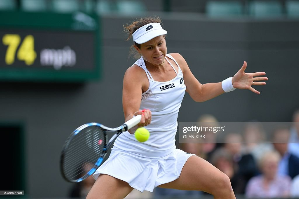Slovakia's Jana Cepelova returns against Spain's Garbine Muguruza during their women's singles second round match on the fourth day of the 2016 Wimbledon Championships at The All England Lawn Tennis Club in Wimbledon, southwest London, on June 30, 2016. / AFP / GLYN