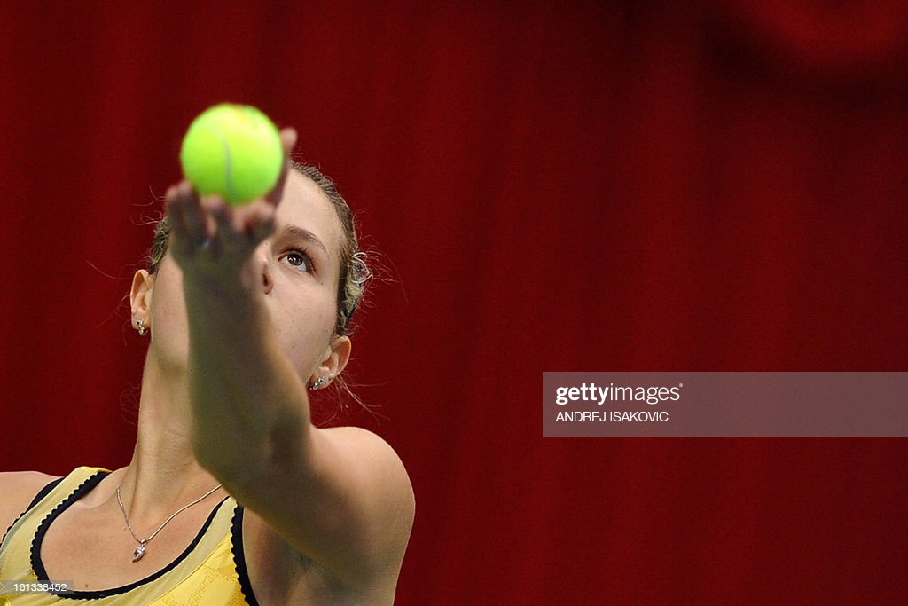 Slovakia's Jana Cepelova serves the ball aginst Serbia's Bojana Jovanovski during the Fed cup World group first round tie tennis match between Serbia and Slovakia on February 10, 2013, in Nis.