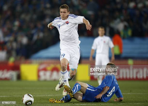 Slovakia's Juraj Kucka and Italy's Daniele De Rossi battle for the ball