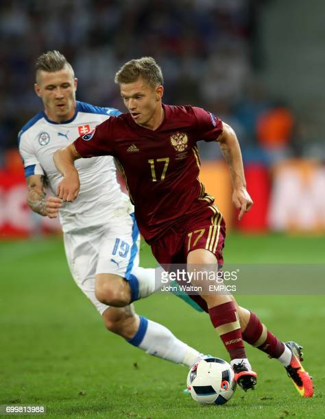 Slovakia's Juraj Kucka and Russia's Oleg Shatov battle for the ball