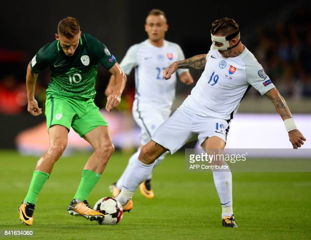Slovakia's Juraj Kucka and Slovenia's Valter Birsa vie for the ball during the FIFA World Cup 2018 qualification football match between Slovakia and...