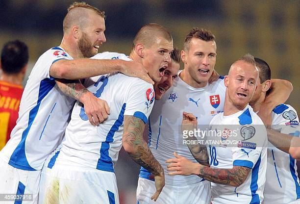 Slovakia's Juraj Kucka celebrates with teammates after scoring during the UEFA Euro 2016 qualifying football match between Macedonia and Slovakia at...