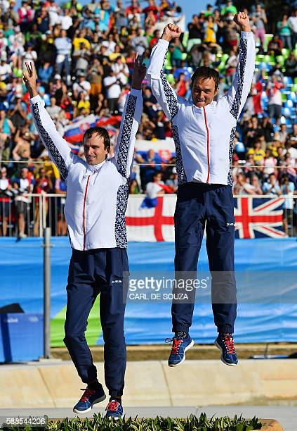 Slovakia's Ladislav and Peter Skantar celebrate with their gold medals on the podium of the Men's C2 final canoe slalom competition at the Whitewater...