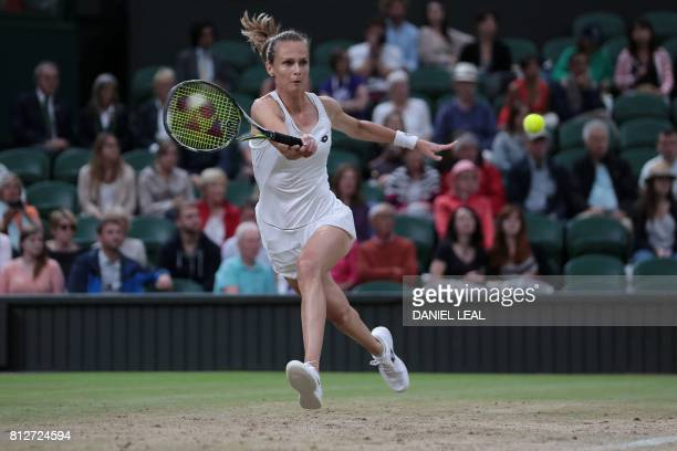 Slovakia's Magdalena Rybarikova returns against US player Coco Vandeweghe during their women's singles quarterfinal match after it recommenced on a...