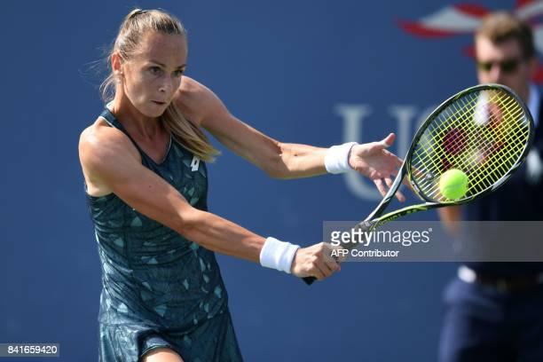 Slovakia's Magdalena Rybarikova returns the ball to Spain's Garbiñe Muguruza during their 2017 US Open Men's Singles match at the USTA Billie Jean...