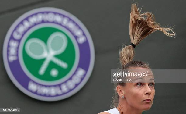 TOPSHOT Slovakia's Magdalena Rybarikova serves against US player Coco Vandeweghe during their women's singles quarterfinal match on the eighth day of...