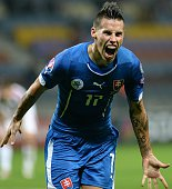 Slovakia's Marek Hamsik celebrates after scoring during the UEFA Euro 2016 qualifying football match between Belarus and Slovakia in Borisov some 100...