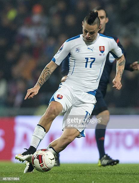 Slovakia's Marek Hamsik controls the ball during the EURO 2016 Group C qualifier football match Slovakia vs Luxembourg in Zilina Slovakia on March 27...