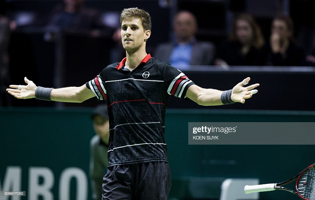 Slovakia's Martin Klizan celebrates his victory over France's Nicolas Mahut at the end of their Rotterdam ATP tournament tennis match, on February 13, 2016 in Rotterdam. / AFP / ANP / Koen Suyk / Netherlands OUT