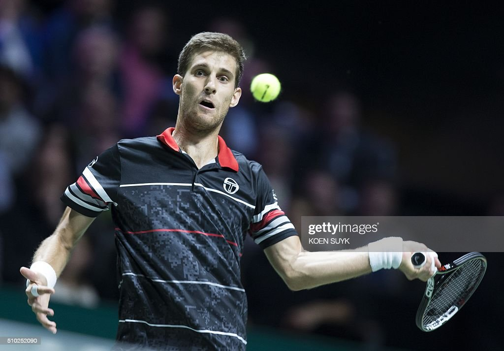 Slovakia's Martin Kliznan hits a return to France's Gael Monfils during their ATP Rotterdam tournament final match, on February 14, 2016 in Rotterdam. / AFP / ANP / Koen Suyk / Netherlands OUT