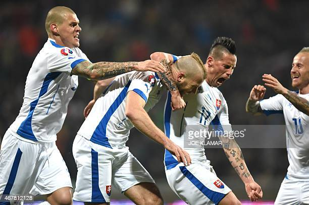 Slovakia's Martin Skrtel Adam Nemec Marek Hamsik and Miroslav Stoch celebrate the 10 goal during the EURO 2016 Group C qualifier football match...