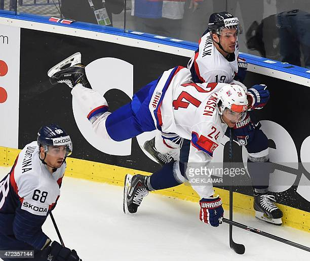 Slovakia's Michel Miklik and Norway's Andreas Martinsen vie for the puck during the group B preliminary round match Slovakia vs Norway during the...