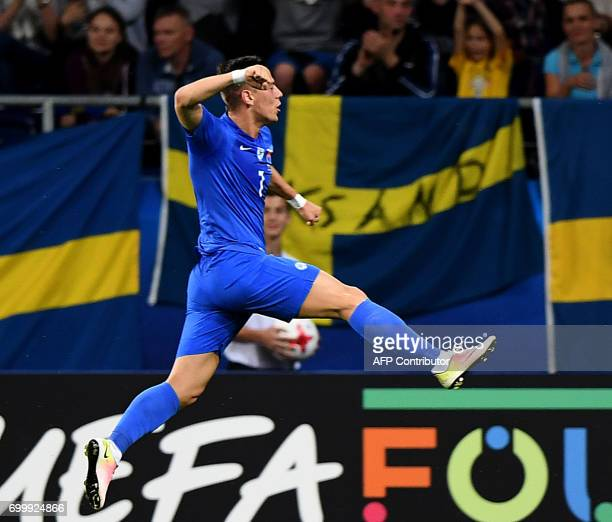 Slovakia's midfielder Jaroslav Mihalik celebrate scoring during the UEFA U21 European Championship roup A football match Slovakia v Sweden in Lublin...