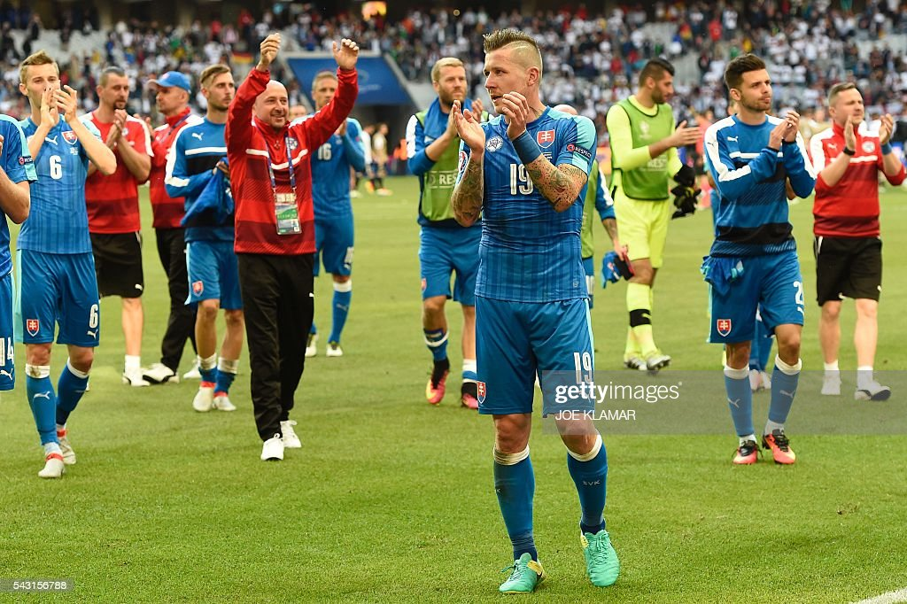 Slovakia's midfielder Juraj Kucka acknowledges supporters at the end of the Euro 2016 round of 16 football match between Germany and Slovakia at the Pierre-Mauroy stadium in Villeneuve-d'Ascq near Lille on June 26, 2016. / AFP / Joe KLAMAR