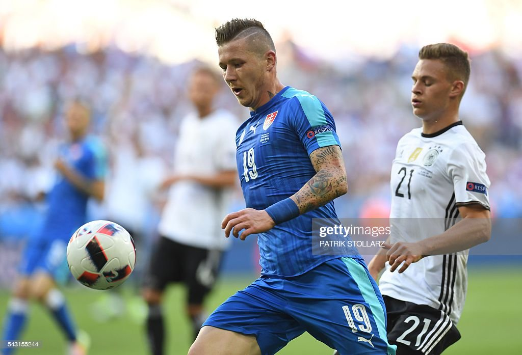 Slovakia's midfielder Juraj Kucka controls the ball during the Euro 2016 round of 16 football match between Germany and Slovakia at the Pierre-Mauroy stadium in Villeneuve-d'Ascq near Lille on June 26, 2016. / AFP / PATRIK