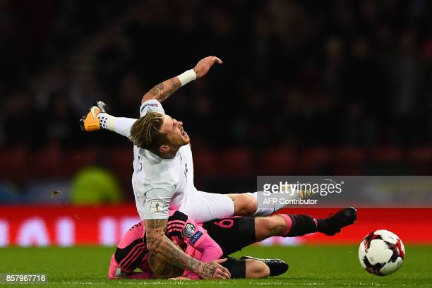 Slovakia's midfielder Juraj Kucka is tackled by Scotland's midfielder Barry Bannan during the FIFA World Cup 2018 qualifying football match between...