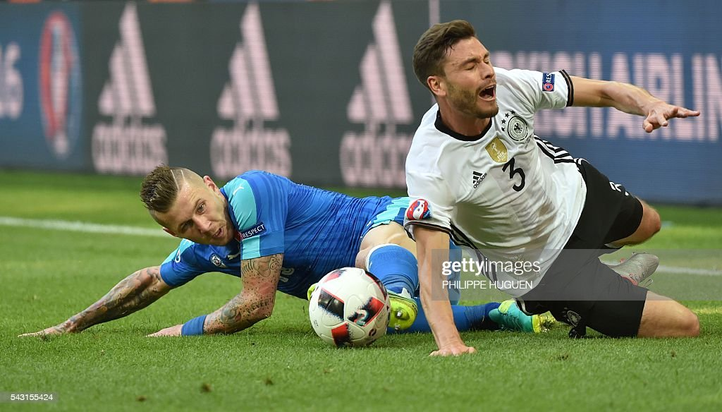 Slovakia's midfielder Juraj Kucka (L) vies with Germany's defender Jonas Hector during the Euro 2016 round of 16 football match between Germany and Slovakia at the Pierre-Mauroy stadium in Villeneuve-d'Ascq, near Lille, on June 26, 2016. / AFP / PHILIPPE