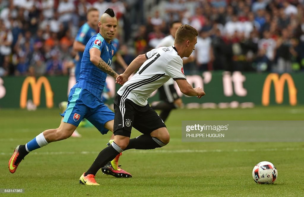 Slovakia's midfielder Juraj Kucka (L) vies with Germany's midfielder Joshua Kimmich during the Euro 2016 round of 16 football match between Germany and Slovakia at the Pierre-Mauroy stadium in Villeneuve-d'Ascq, near Lille, on June 26, 2016. / AFP / PHILIPPE