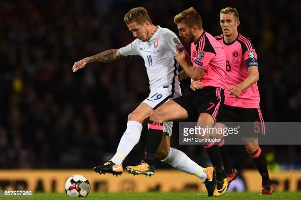 Slovakia's midfielder Juraj Kucka vies with Scotland's midfielder James Morrison during the FIFA World Cup 2018 qualifying football match between...