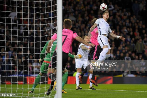 Slovakia's midfielder Juraj Kucka wins a header in the Scotland area during the FIFA World Cup 2018 qualifying football match between Scotland and...